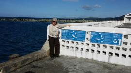 Suki with the new RPI signs on Mosquito Pier.