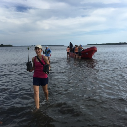 ICAPO Biologist, Aida, leads S.W.I.M. participants to plant mangroves.