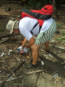 LMC S.W.I.M. participant collects debris during a beach cleanup in the Padre Ramos Natural Preserve.