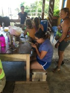 LMC S.W.I.M. participant weaving a bracelet out of repurposed plastic bags. Padre Ramos Natural Preserve.