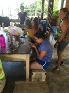 LMC S.W.I.M. participant weaving a bracelet out of repurposed plastic bags. Padre Ramos Natural Preserve.