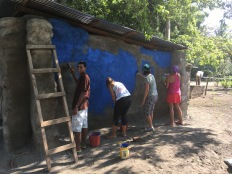 LMC S.W.I.M. participants paint the storage shed at the field house location.