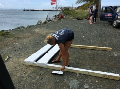 Intern, Stephanie, painting the sign posts.