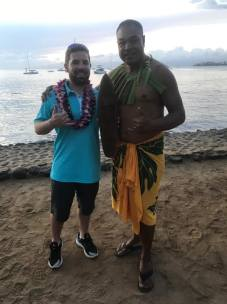 SWIM guest poses for a quick picture with a local Maui wood artisan.